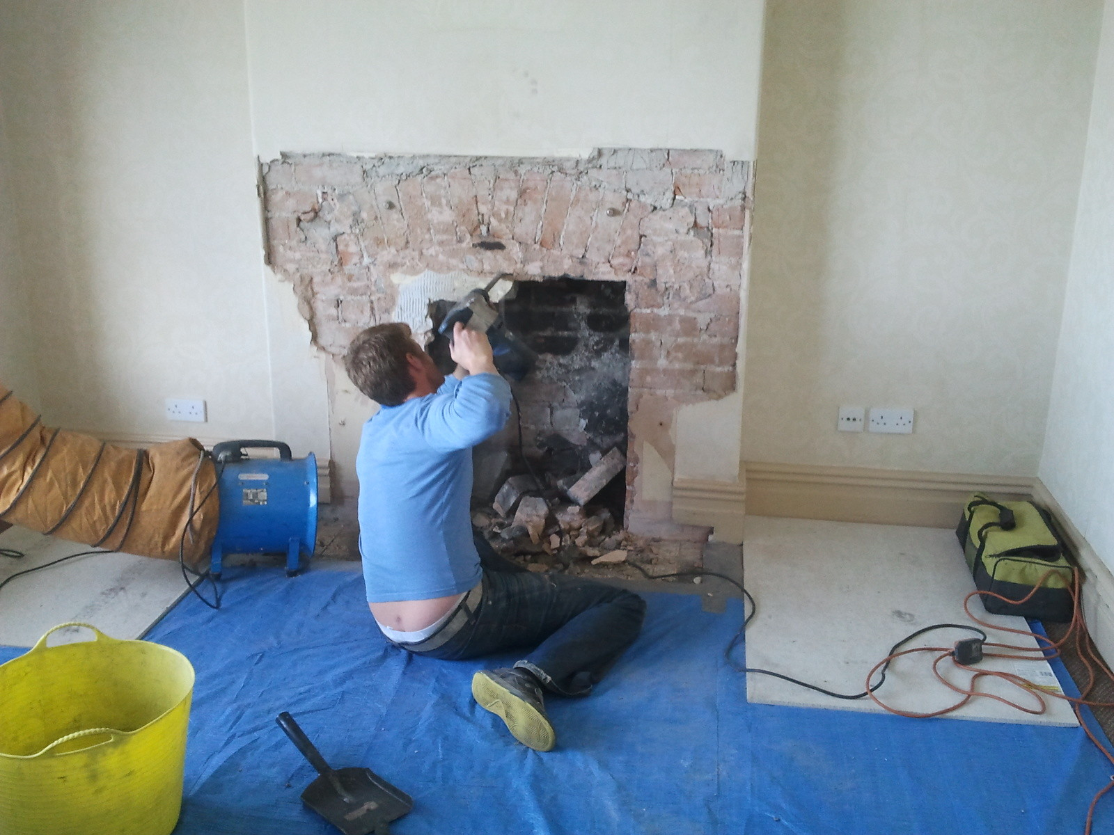 opening up a fireplace for the installation of a wood burning