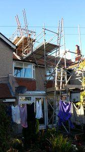 Scaffolding for chimney flue liner