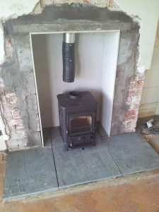 Awesome Wood Burning Stove In A Fireplace Connected To A Chimney Interior Design Ideas Greaswefileorg