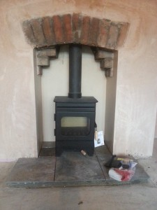 wood burning stove brick arch