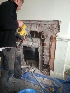 Enlarging a fireplace to the builder's opening for a wood burning stove